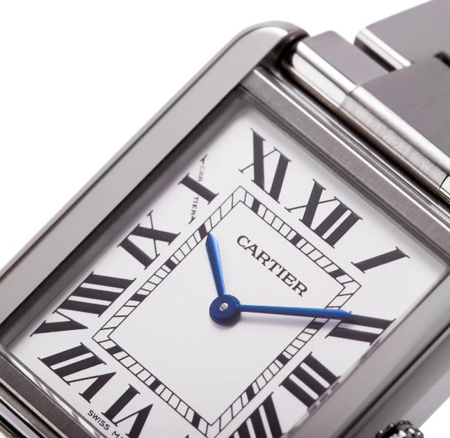 The elegant watches fake Cartier Tank Solo W5200013 have silver-plated dials, black Roman numerals and blue hands.