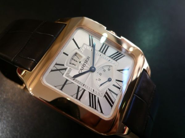The large size replica Santos De Cartier Santos-Dumont W2020067 watches have silver-plated dials with power reserve displays and date windows.