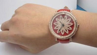 The luxury replica Cartier watches are made from rose gold and decorated with diamonds.
