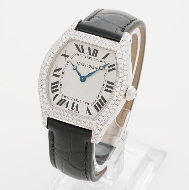 The 18k white gold copy Cartier Tortue WA503851 watches have black alligator leather straps.