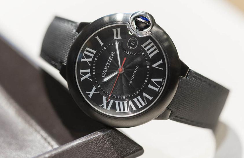 The stainless steel fake watches have black straps.